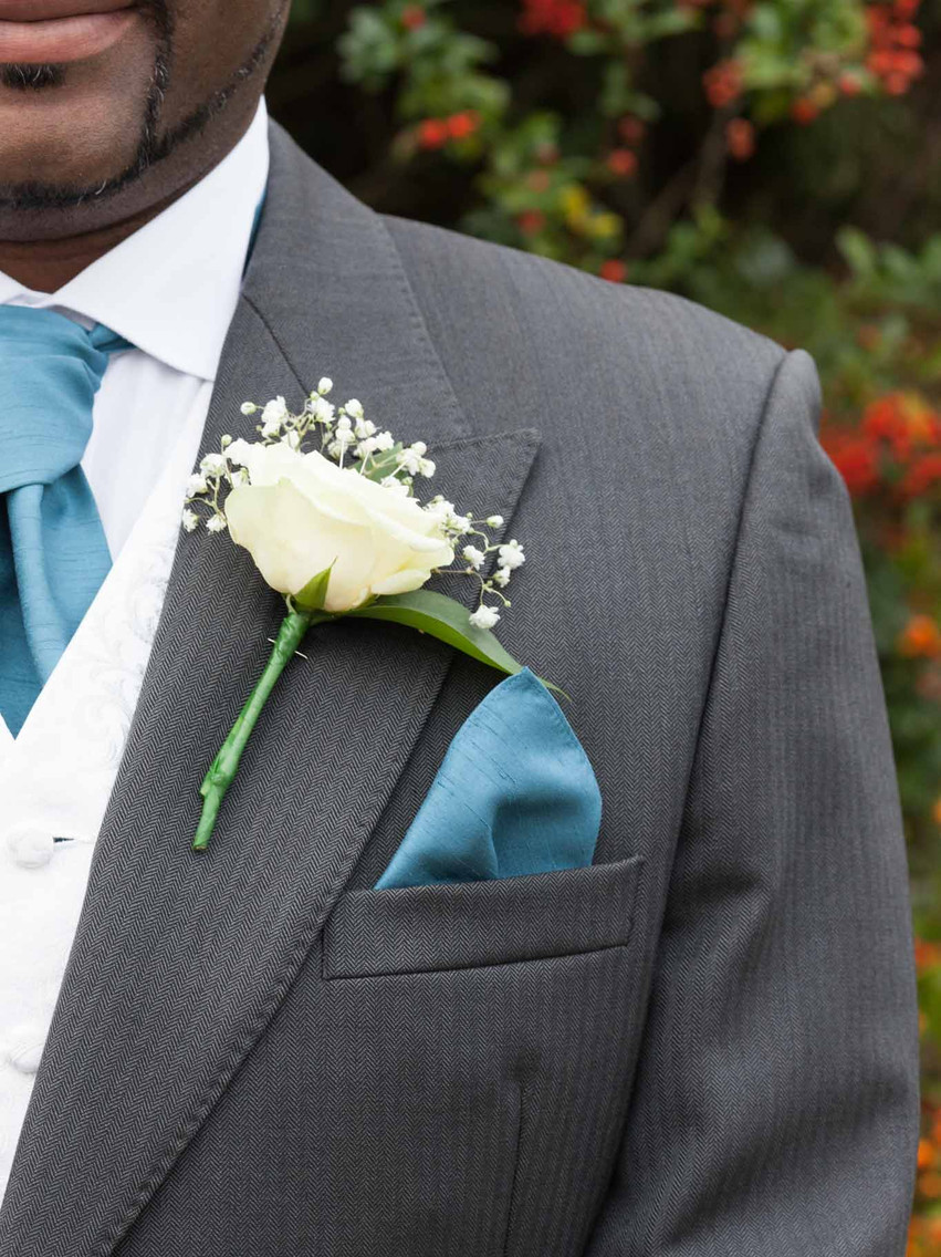 close up of a grooms buttonhole