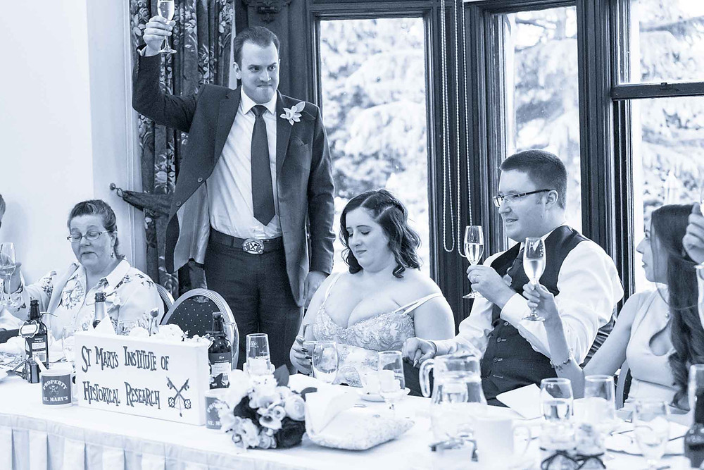 best man toasting the happy couple
