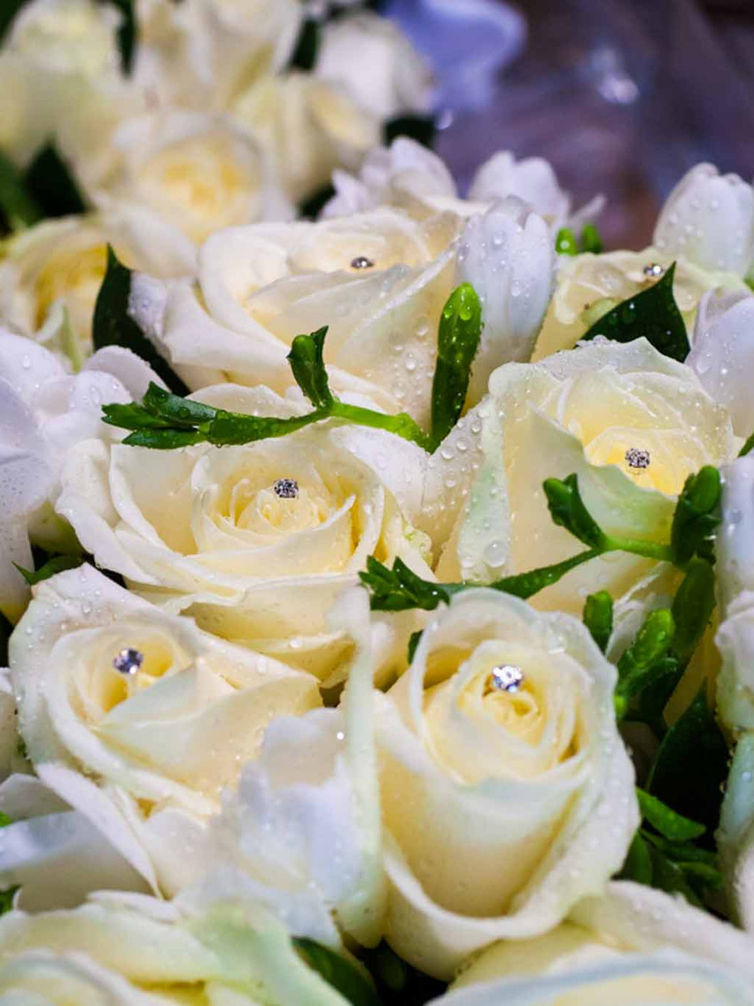 bridal flowers on a table covered in water droplets