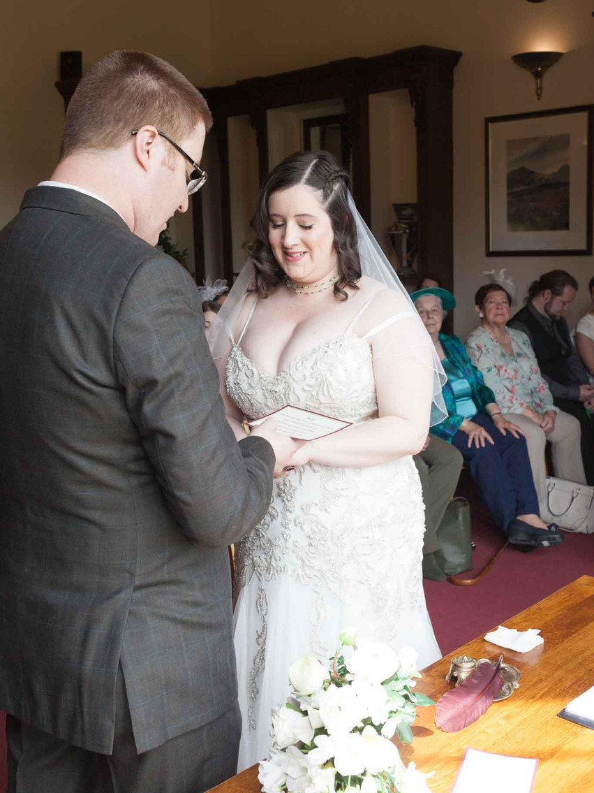 bride and groom at the altar by a window