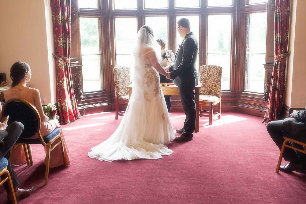couple at the altar in a sunbathed room