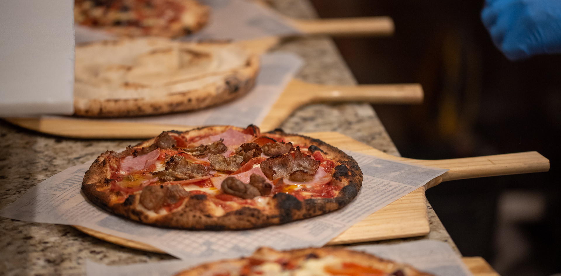 Three pizzas ready to go