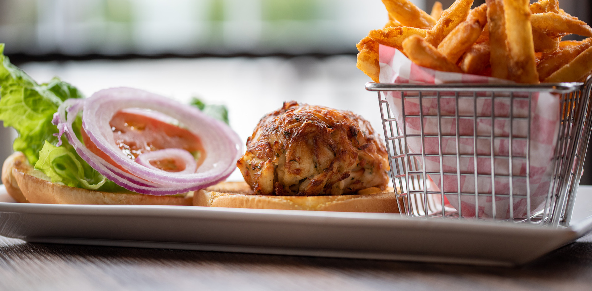A Crab Cake Sandwich And Fries