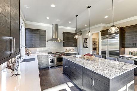 Modern Gray Kitchen Features Dark Gray Flat Front Cabinets.jpg