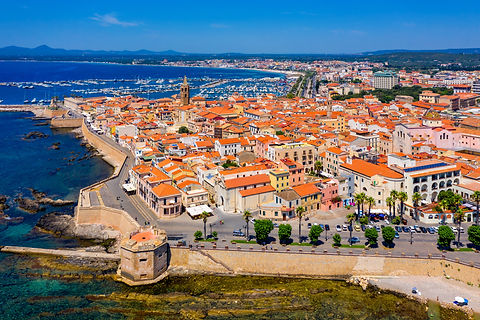 Aerial view over Alghero old town, citys