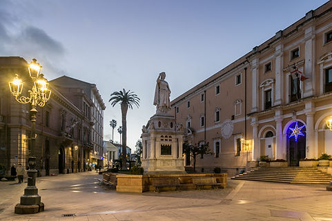 Olbia by Night, statue, lamp post and bu