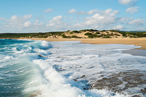 Piscinas beach dunes  and waves in  Gree
