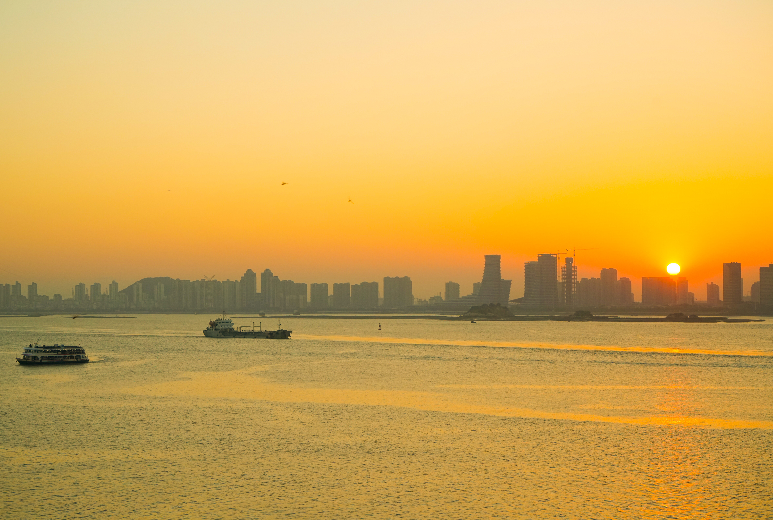 Xiamen by the sea under sunset light