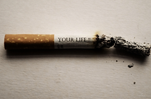A burning cigarette with the words saying 'YOUR LIFE'