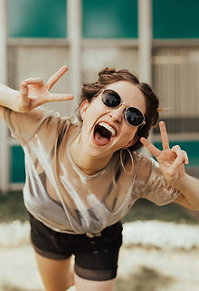 A woman celebrating giving up smoking