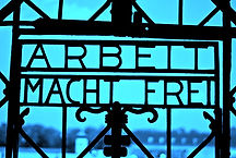 "arbeit macht frei is a German phrase meaning ""work makes you free."""