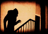 nosferatu iconic scene of the shadow of count orlok climbing up a staircase to his victim