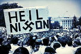 One of the more darkly labeled rallying signs, this poster compares President Nixon to Hitler, substituting a swastika for the 'x' in Nixon's name.