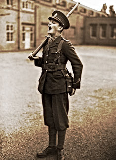 A member of the Eton public school O.T.C. (Officers Training Corps) practising shouting out orders.
