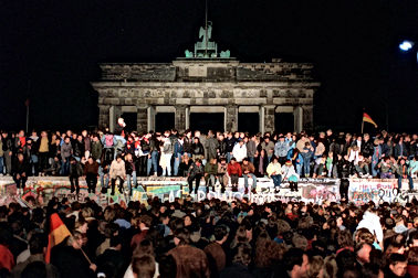Though its crossing would remain closed for another several weeks, the Brandenburg Gate, blocked off for years due to the wall's presence, became another gathering point for celebrating Germans.