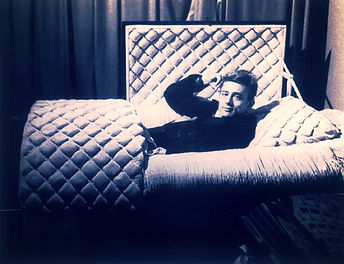 James Dean posing with a coffin1955