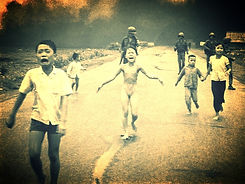 iconic picture of civilians burned by an accidental napalm bombing flee. 9 year old Pham Thi Kim Phuc