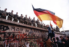 Berlin wall with soldiers on top