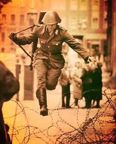 15 September 1961: Conrad Schumann, a 19-year-old East German soldier, jumps over a barbed wire fence and defects into West Germany on the third day of the construction of the Wall.