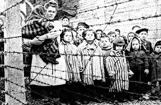 camp children behind barbed wire