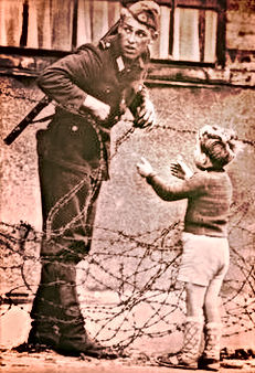 barbed wire soldier and child berlin wall