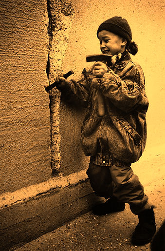 The wall didn't fall in a day. On Dec. 31, a little girl chiseled away at the Berlin Wall from the east side.