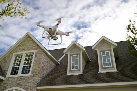 Drone%20in%20front%20of%20house_edited.j