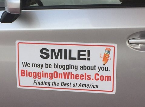 car with blogging sign