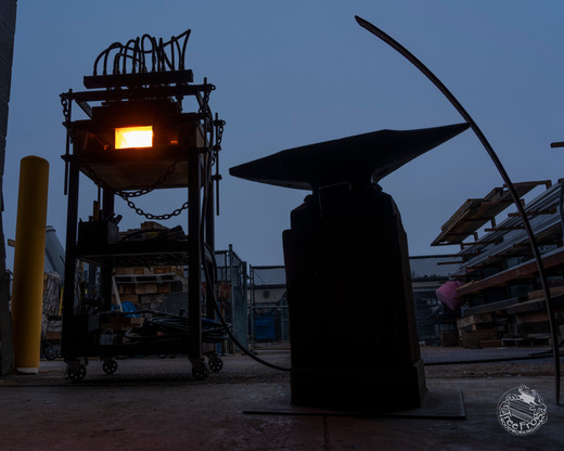 Forging steel in the yard at daybreak