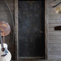 industrial steel and reclaimed wood door