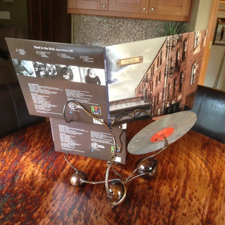 sculpted steel record display stand.JPG