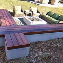 floating wood bench with concrete base
