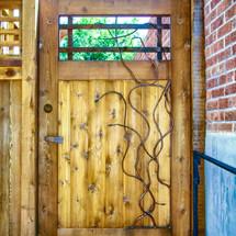 cedar gate with sculpted steel