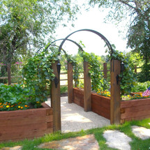 wood and steel garden pathway arch