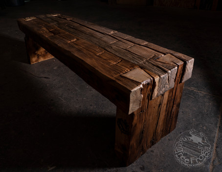Hand-hewn antique barn beam bench with dovetailed legs
