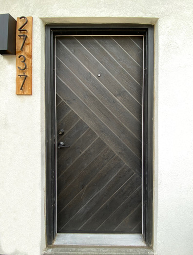Shou sugi ban and aluminum entry door