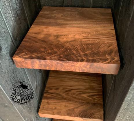 Floating walnut shelves, shou sugi ban clad closet