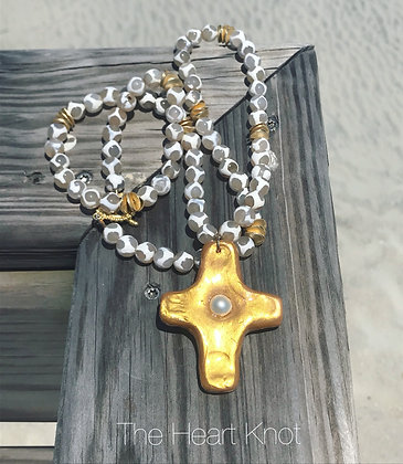 White Tzi Beads on Gold Cross with Pearl Cabochon