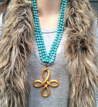 Cross Knot on Turquoise Magnesite Beads 80in