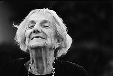 Black and White gelatin silver print phoograph of older woman smiling.