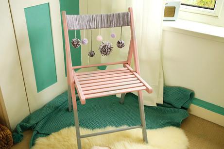 Pink pom-pom chair
