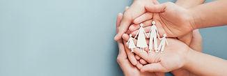 hands-holding-paper-family.jpg