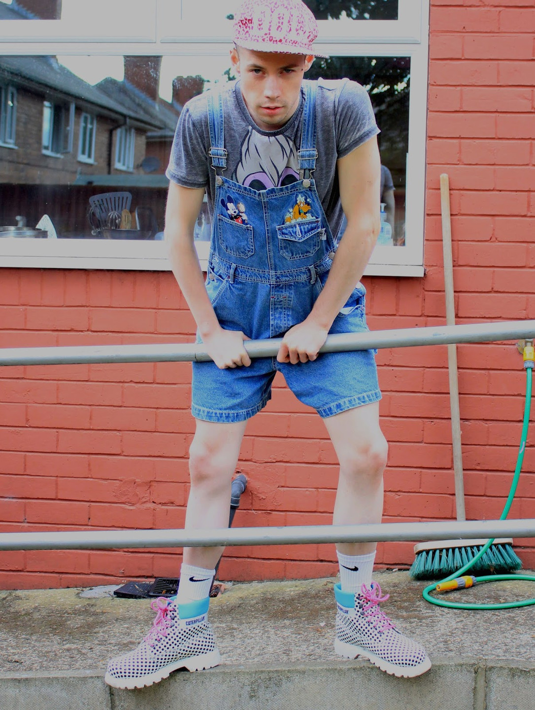Photographed by Natalie Marsh. Edited and styled by Peter Marsh.  Hat- Nikki Lipstick, t-shirt- Primark,   dungarees- vintage Disney,  socks- Nike, boots- Caterpillar.