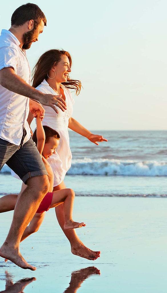 Family on beach for web.jpg