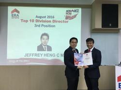 Jeffrey receiving Top Achiever Award. Advisers received Top Achiever Award, Navis Living Group, ERA