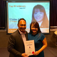 Elaine receiving August 2017 Top Achiever Award.
