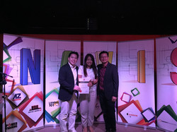 Jeffrey and Elaine receiving Top Achiever Award.