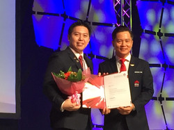 Jeffrey receiving Top Achiever Award.