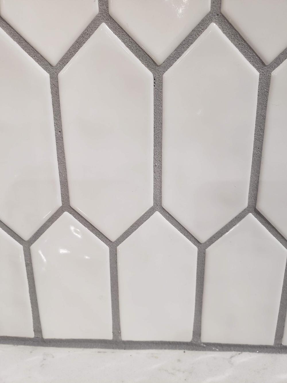 white picket backsplash with grey grout