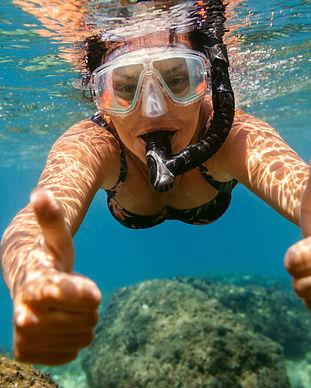 woman-snorkelling-under-water-C3K9D8E.JPG
